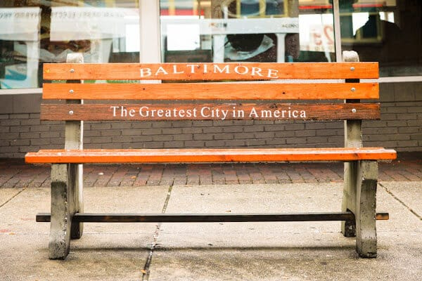 sidewalk bench with baltimore engraved on back rest